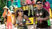 A happy couple dances to music played by a live band at Discover Island Carnivale
