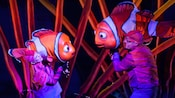 Actors holding Nemo and his father Marlin at Finding Nemo - The Musical