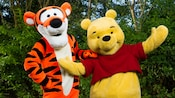 Tigger stands next to Winnie the Pooh at Meet Hundred Acre Wood Friends at Discovery Island