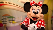 Minnie clasps her hands with excitement at Meet Disney Pals at the Epcot Character Spot