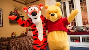 Winnie the Pooh and Tigger wave hello at Meet Winnie the Pooh & Friends in the United Kingdom
