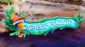 The attraction sign outside Ariel's Grotto featuring a trumpet-playing seahorse