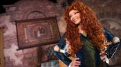 Merida with her hands on her hips at Fairytale Garden in Fantasyland at Magic Kingdom park