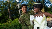 Prince Naveen flirts with Princess Tiana at Meet Tiana in Liberty Square