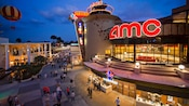 Guests gather outside the AMC Movies at Downtown Disney 24 theatres at sunset
