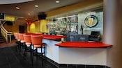 A modern bar with high chair-stools at AMC Downtown Disney 24 Theatres