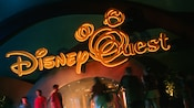 Disney Quest sign lit up at night