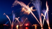 Pyrotechnics fill the night sky as balls of fire shoot into the air