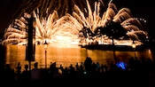 The lagoon is lit up by shimmering pyrotechnics