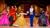 Belle and her Prince with other characters from the show: Beauty and the Beast – Live on Stage at Disney's Hollywood Studios