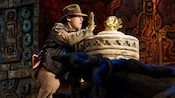 Indiana Jones prepares to grab the golden idol from Raiders of the Lost Ark