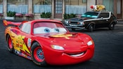 Lightning McQueen and an enemy car at the Lights, Motors, Action! Extreme Stunt Show