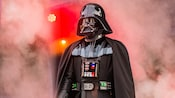 Darth Vader stands in front of a wall of smoke
