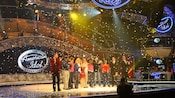 Confetti rains down on contestants on stage at The American Idol Experience at Disney's Hollywood Studios