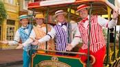 The Dapper Dans pose on a horse-driven trolley car on Main Street, U.S.A.