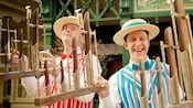 Two members of the Dapper Dans hold Deagan Organ Chimes on Main Street, U.S.A.