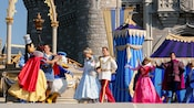 Princesses and Princes strut on stage during Dream-Along With Mickey