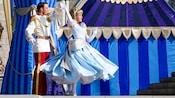 Prince Charming twirls Cinderella during the Dream-Along With Mickey show