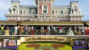 "Entrance to Magic Kingdom park with a sign ""Let the Memories Begin"" and the train station beyond"