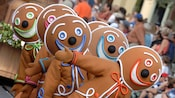 Dancing Gingerbread men lead their float through Disney Parks Christmas Day Parade