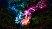 Swirling lights magically form the shape of hummingbirds and flowers on the Tree of Life