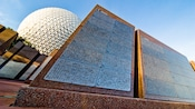 Close-up of 2 polished granite monoliths with Spaceships Earth in the background at Epcot theme park