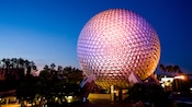 The iconic Spaceship Earth lit up at night at Epcot theme park