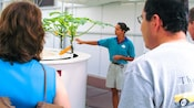 Cast member identifying a plant for 2 Guests