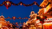 Holiday ornaments, lights, wreaths and bows light up the night on Main Street, U.S.A.