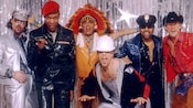 The 6 members of the Village People disco group dressed in various costumes