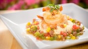 Shrimp and stone-ground grits with sausage, corn, tomato and cilantro