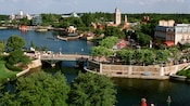 Overview of a section of World Showcase Lagoon rimmed with international pavilions at Epcot