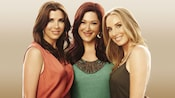 Carny Wilson and group members of the musical trio Wilson Phillips smiling together