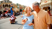 A couple enjoys strolling on Main Street USA.