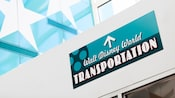 Walt Disney World Transportation sign with an arrow pointing straight ahead