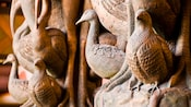Close-up of carved wooden sculpture of different kinds of birds, including ducks, partridges and pelicans