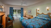 Room with blue bedding, draperies, coffee table and chair cushions