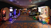 A dimly lit arcade in a room lined with video games