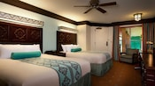 2 beds with oversized wood-paneled headboards and white-and-turquoise bedding