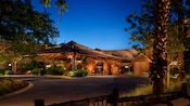 A nighttime exterior view of the main building of Disney's Animal Kingdom Villas – Kidani Village