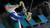A jazzy alligator sculpture playing a water-squirting saxophone