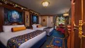 Royal bedroom with curtained river view, regal beds with tall elaborate headboards, elegant armoire