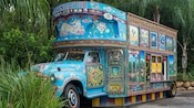 Vibrant designs of real and mythical animals detailing the exterior of a bus-turned-ice cream stand