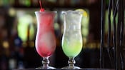 Dawa Coloda with a cherry and African Margarita with a slice of lime in hurricane glasses
