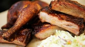 A barbecued Ribs and Chicken Combo plate served with coleslaw