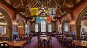 Gothic arches and heraldic banners in the main dining room at Akershus Royal Banquet Hall