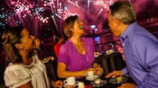 Three Guests delight in dessert while watching IllumiNations: Reflections of Earth fireworks show