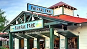 Partial exterior of the Fairfax Fare building and its 2 signs