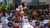 Jedi Mickey, Princess Leia Minnie & Ewok Chip wave during a live procession at 'Star Wars' Weekends