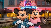 Mickey and Minnie Mouse are dressed to thrill while standing in front of the Hollywood and Vine marquee